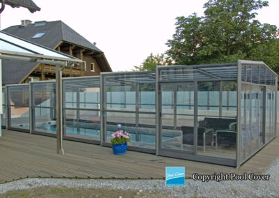 high-enclosure-pool-cover-bronze-grey-without-rail-in-the-garden