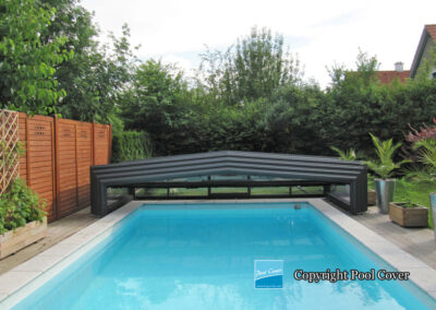 low-enclosures-pool-cover-black-without-rail-in-the-garden